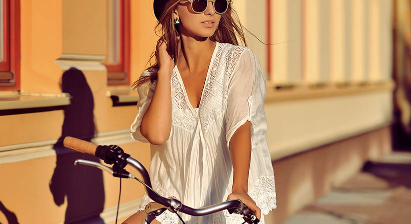 Beautiful hipster girl on a bicycle