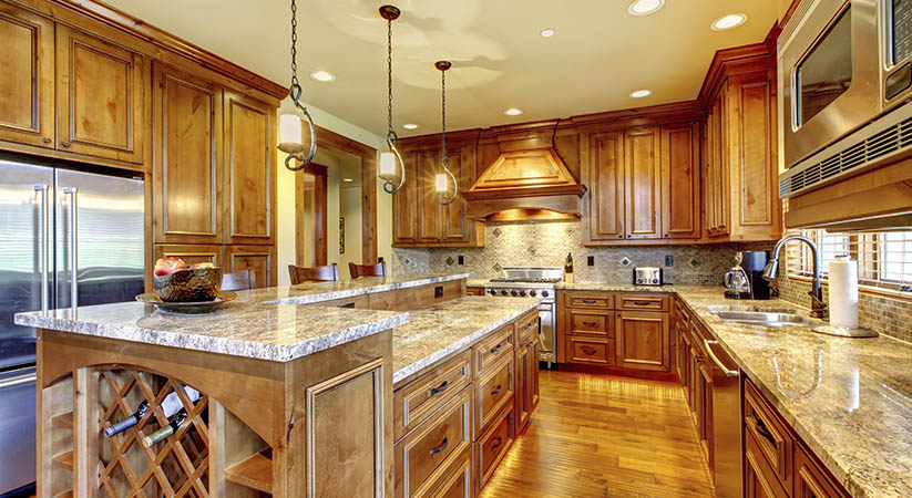 Mountain luxury home with wood kitchen and granite countertop.